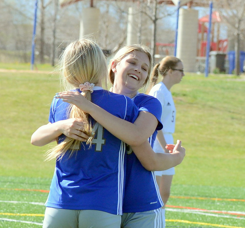 . Resurrection Christian\'s Maddie Crutcher (24) gets a hug from Jadyn Hanson after scoring against Estes Park during Thursday\'s Patriot League game at Loveland Sports Park. (Mike Brohard/Loveland Reporter-Herald)
