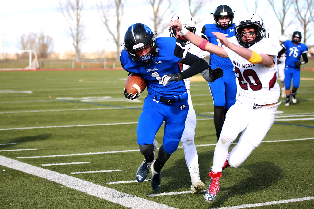 . Resurrection Christian�s (1) Colton Stahla runs with the ball during as Alamosa�s (20) Luke Smith tries to take him out during their game at Windsor High School on Nov. 3, 2018 in Windsor, Colo. Photo by Taelyn Livingston/ Loveland Reporter-Herald