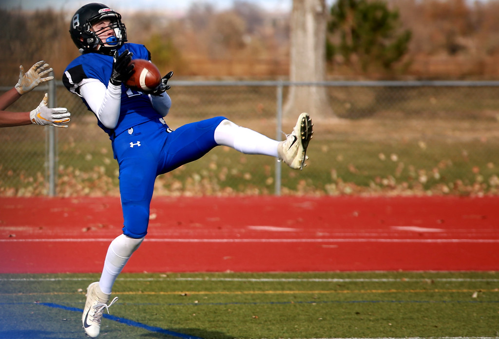 . Resurrection Christian�s (8) Eddie Lemos catches an interception during their game against Alamosa at Windsor High School on Nov. 3, 2018 in Windsor, Colo. Photo by Taelyn Livingston/ Loveland Reporter-Herald