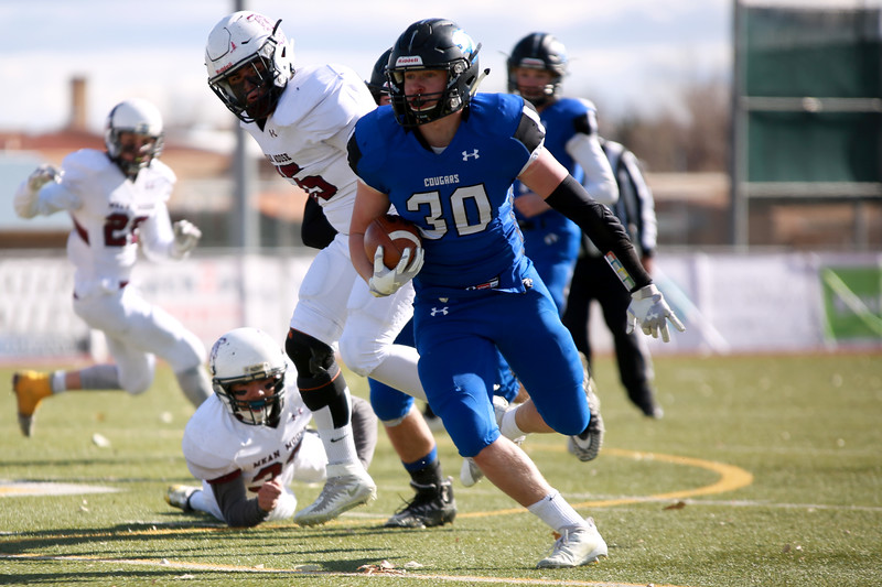 Resurrection Christian's (30) Kyle Lueck runs with the ball during their game against Alamosa at Windsor High School on Nov. 3, 2018 in Windsor, Colo.<br /> Photo by Taelyn Livingston/ Loveland Reporter-Herald
