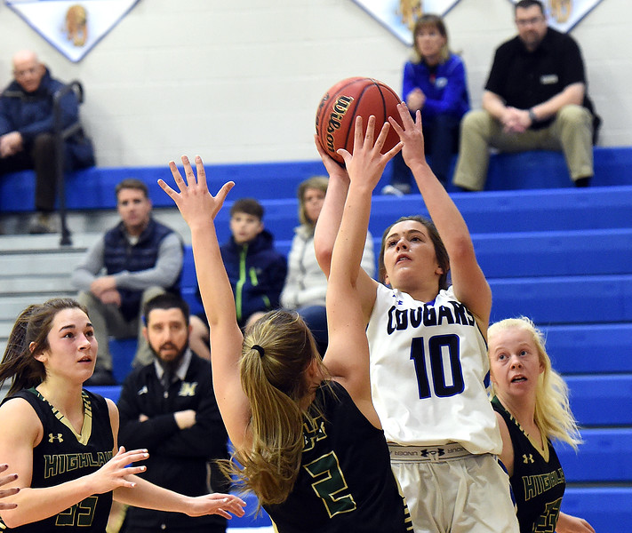 Resurrection Christian's Juju Hemeyer goes up for a shot past Highland's Alyssa Winter during their game Tuesday, Dec. 18, 2018, at Resurrection Christian School in Loveland.  (Photo by Jenny Sparks/Loveland Reporter-Herald)