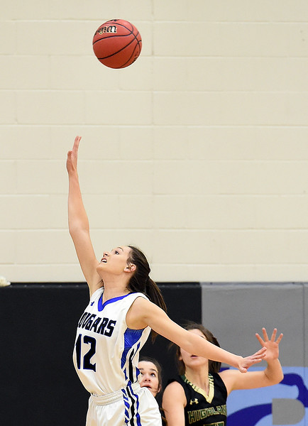 Resurrection Christian's Kaari Ausenhus tries to block a shot during their game against Highland Tuesday, Dec. 18, 2018, at Resurrection Christian School in Loveland.  (Photo by Jenny Sparks/Loveland Reporter-Herald)