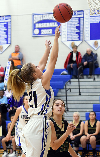 Resurrection Christian's ElisabethPerl goes up for a shot past Highland's Olivia Himmel during their game Tuesday, Dec. 18, 2018, at Resurrection Christian School in Loveland.  (Photo by Jenny Sparks/Loveland Reporter-Herald)