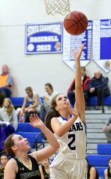 Resurrection Christian's Molli Peacock goes up for a shot past Highland's Lauren Frink during their game Tuesday, Dec. 18, 2018, at Resurrection Christian School in Loveland.  (Photo by Jenny Sparks/Loveland Reporter-Herald)