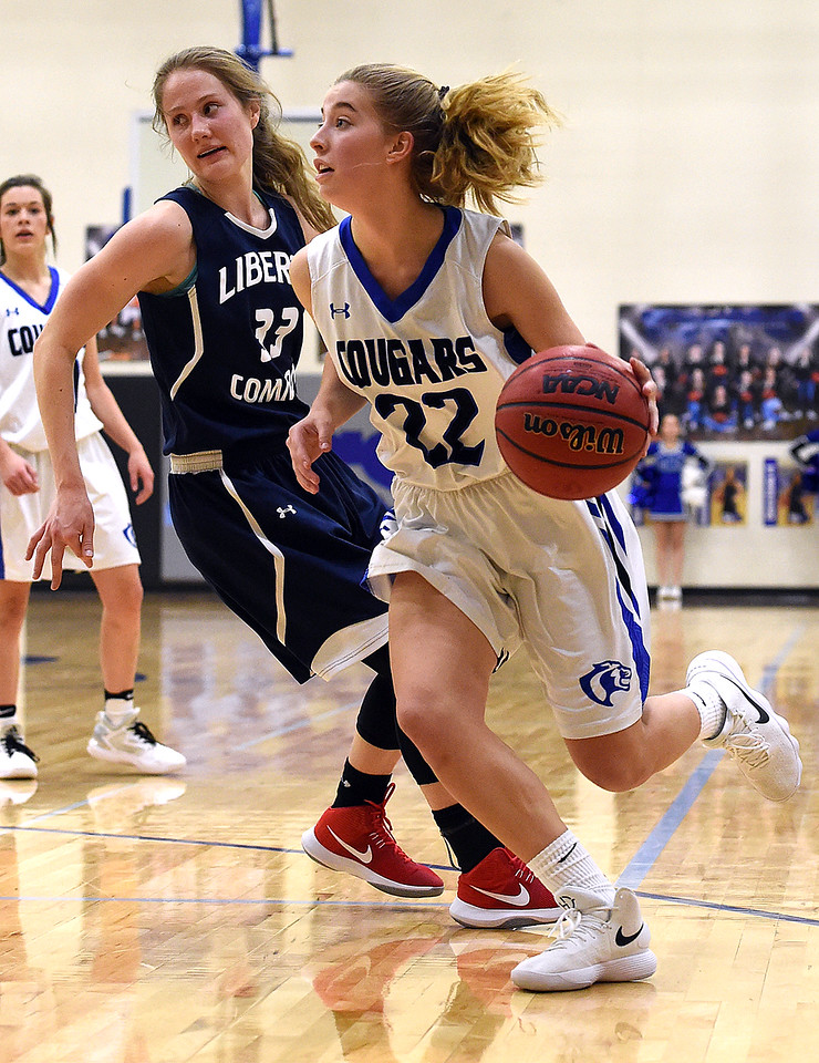 Resurrection Christian's (22) Elisabeth Perl takes the ball down court during their game against Liberty Commons Thursday, Jan. 18, 2018, at Resurrection Christian School in Loveland. (Photo by Jenny Sparks/Loveland Reporter-Herald)