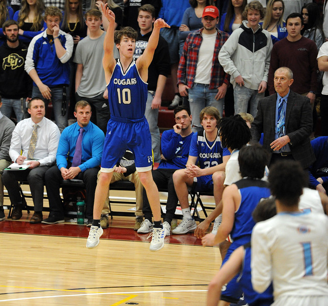Jude Howell release a 3-pointer during Resurrection Christian's Great 8 game against Manual at Magness Arena on Thursday, March 7. (Colin Barnard/Loveland Reporter-Herald)