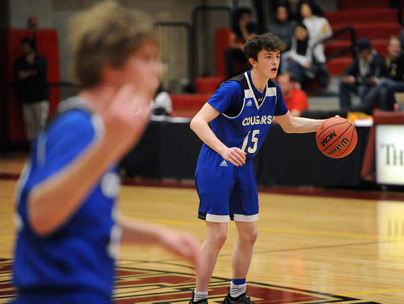 Ethan Reeser studies the defense during Resurrection Christian's Great 8 game against Manual at Magness Arena on Thursday, March 7. (Colin Barnard/Loveland Reporter-Herald)