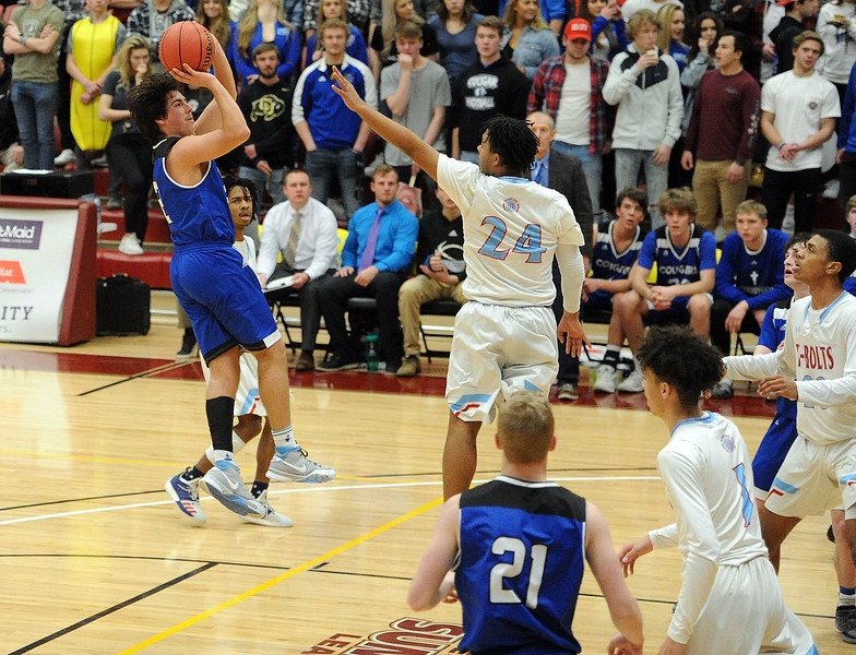 Jackson Romero rises up for a jumper during Resurrection Christian's Great 8 game against Manual at Magness Arena on Thursday, March 7. (Colin Barnard/Loveland Reporter-Herald)