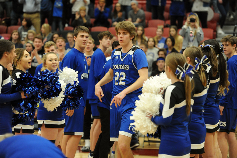 Sparky Morris runs through teammates and cheerleaders before Resurrection Christian's Great 8 game against Manual at Magness Arena on Thursday, March 7. (Colin Barnard/Loveland Reporter-Herald)
