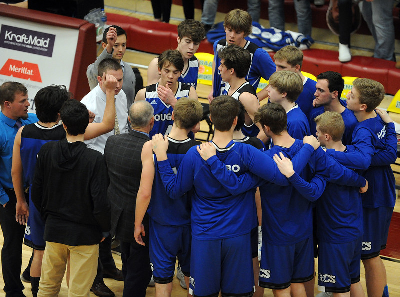Resurrection Christian gathers for a huddle during its Great 8 game against Manual at Magness Arena on Thursday, March 7. (Colin Barnard/Loveland Reporter-Herald)