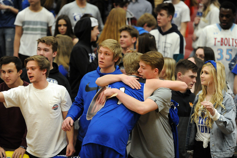 Logan Jones hugs a friend after Resurrection Christian's Great 8 game against Manual at Magness Arena on Thursday, March 7. (Colin Barnard/Loveland Reporter-Herald)