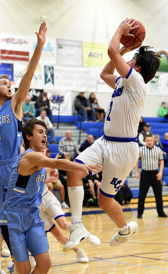Resurrection Christian's (2) Jackson Romero goes up for a shot during their game against Platte Valley Tuesday, Jan. 16, 2018, at Resurrection Christian School in Loveland.  (Photo by Jenny Sparks/Loveland Reporter-Herald)