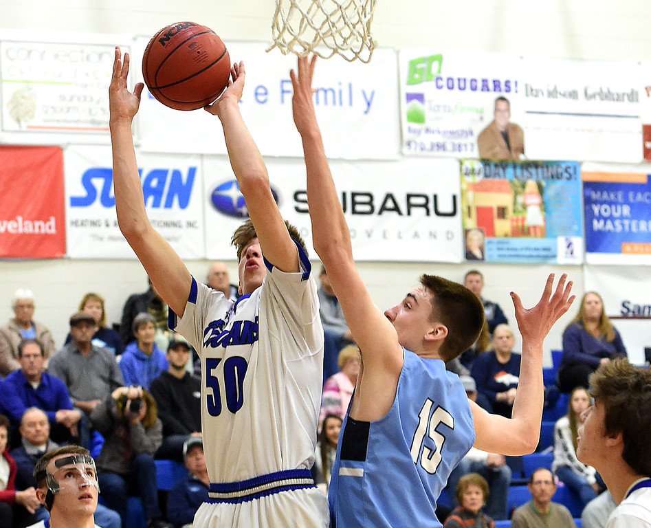 Resurrection Christian's (50) Caleb Geisendorfer goes up for a shot past Platte Valley's (15) Bryson Becker during their game Tuesday, Jan. 16, 2018, at Resurrection Christian School in Loveland.  (Photo by Jenny Sparks/Loveland Reporter-Herald)