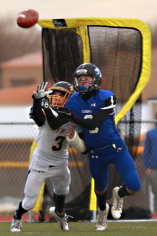 . Resurrection Christian�s (3) Will Schrotenboer and Rifle�s (3) Kenny Tlaxcala go for the catch during their game against Rifle in the 2A state playoffs at Windsor High School on Saturday, Nov. 10, 2018 in Windsor, Colo.