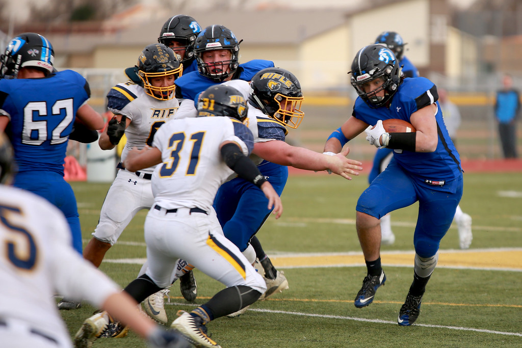 . Resurrection Christian�s (34) Daniel Kelley runs with the ball during their game against Rifle in the 2A state playoffs at Windsor High School on Saturday, Nov. 10, 2018 in Windsor, Colo.