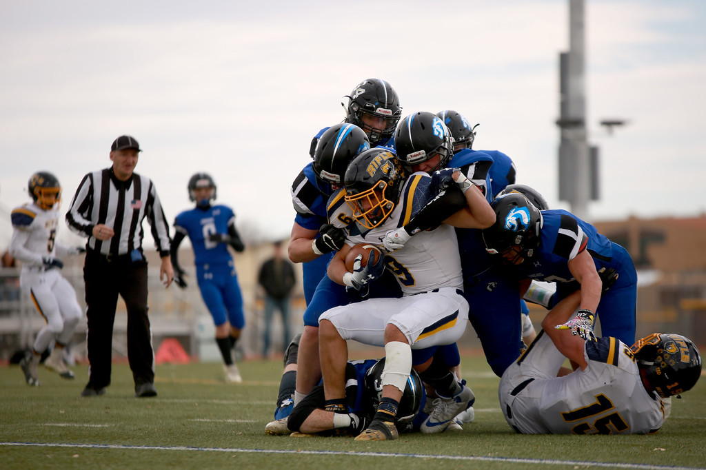 . Resurrection Christian players tackle Rifle�s (9) Tanner Vines during in the 2A state playoffs at Windsor High School on Saturday, Nov. 10, 2018 in Windsor, Colo.