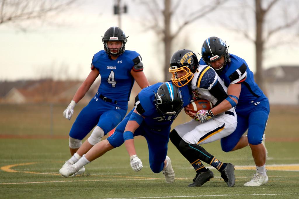 . Resurrection Christian�s (4) Zane Zuhlke (30) Kyle Lueck and (13) Alex Riedel tackle Rifle�s (7) Holden Stutsman in the 2A state playoffs at Windsor High School on Saturday, Nov. 10, 2018 in Windsor, Colo.