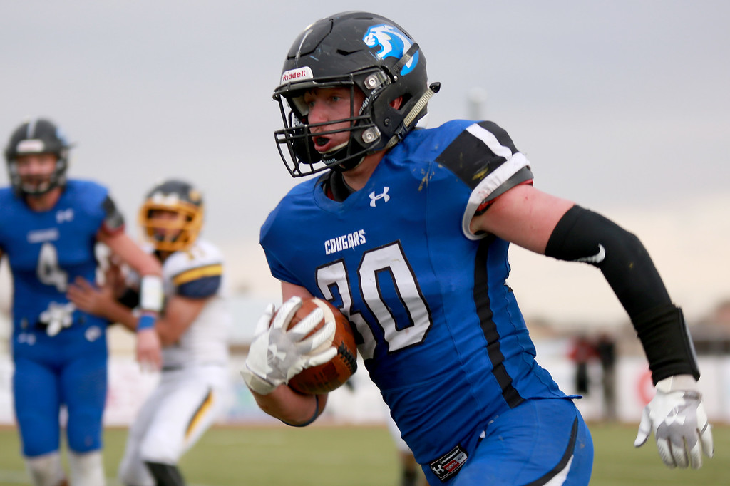 . Resurrection Christian�s (30) Kyle Lueck runs with the ball during their game against Rifle in the 2A state playoffs at Windsor High School on Saturday, Nov. 10, 2018 in Windsor, Colo.Photo by Taelyn Livingston/ Loveland Reporter-Herald