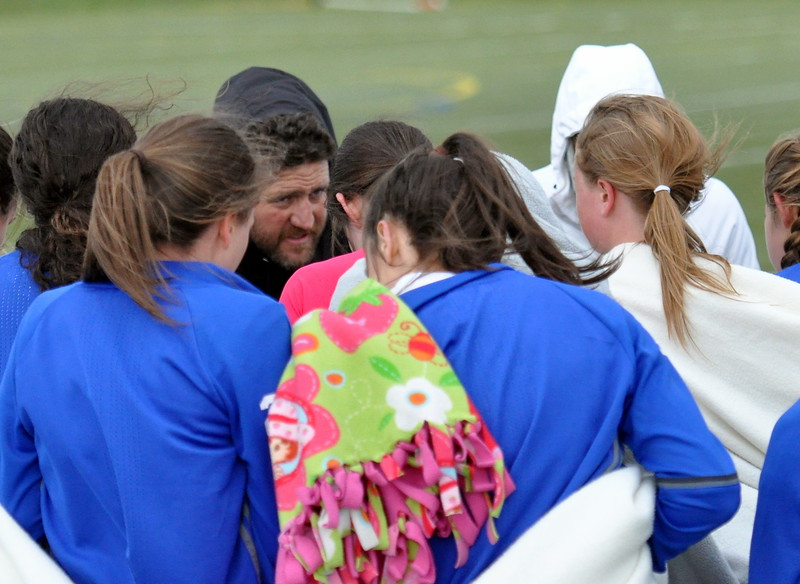 Resurrection Christian coach Randy Wolf, middle, gives final instructions before extra time against Sterling on Tuesday April 25, 2107 at Loveland Sports Park. (Cris Tiller / Loveland Reporter-Herald)