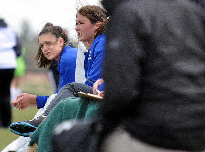 Resurrection Christian substitutes look on from the bench against Sterling on Tuesday April 25, 2017 at Loveland Sports Park. (Cris Tiller / Loveland Reporter-Herald)