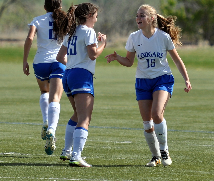 Resurrection Christian's Gavin Wolf (15) celebrates with teammate Whitney Klausner after scoring a goal against Sterling on Tuesday April 25, 2017 at Loveland Sports Park. (Cris Tiller / Loveland Reporter-Herald)