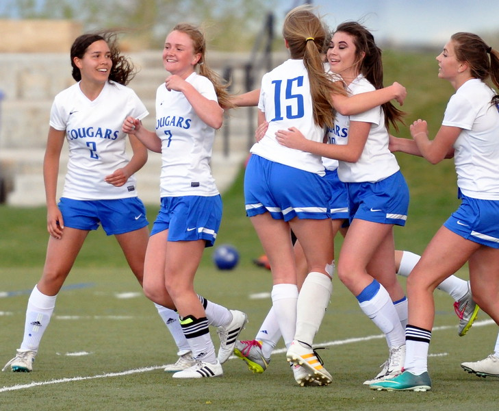 Resurrection Christian's Olivia Swan (7) and teammates celebrate her game-winning goal late in extra time against Sterling on Tuesday April 25, 2017 at Loveland Sports Park. (Cris Tiller / Loveland Reporter-Herald)