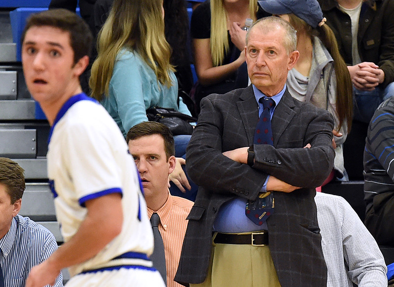 Resurrection Christian basketball coach Bruce Dick keeps an eye on the plays during their game Tuesday, Feb. 7, 2017, at Resurrection Christan School in Loveland. (Photo by Jenny Sparks/Loveland Reporter-Herald)