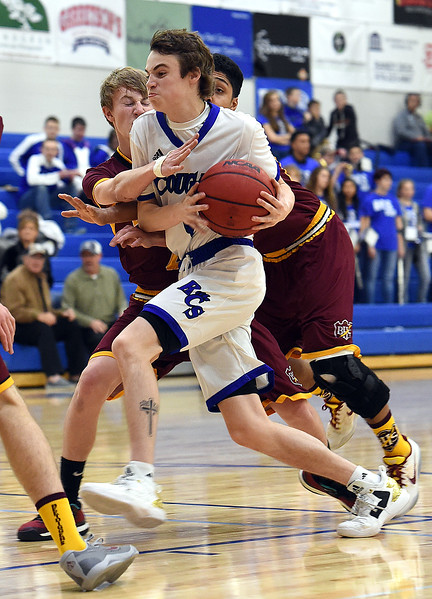 Resurrection Christian's #4 Tanner Ervin gets past Brush's #2 Korbin Massey, left, and #15 Adrian Lopez during their game Friday, Jan. 13, 2017, at Resurrection Christian School in Loveland. (Photo by Jenny Sparks/Loveland Reporter-Herald)