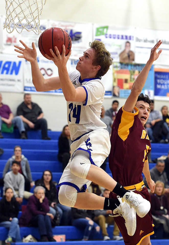 Resurrection Christian's #24 Mike Stevenson goes up for a shot during their game against Brush High School Friday, Jan. 13, 2017, at Resurrection Christian School in Loveland. (Photo by Jenny Sparks/Loveland Reporter-Herald)