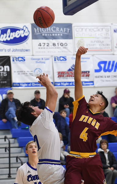 Resurrection Christian's #2 Jackson Romero and Brush's #4 Armando Saucedo go up for a rebound during their game Friday, Jan. 13, 2017, at Resurrection Christian School in Loveland. (Photo by Jenny Sparks/Loveland Reporter-Herald)