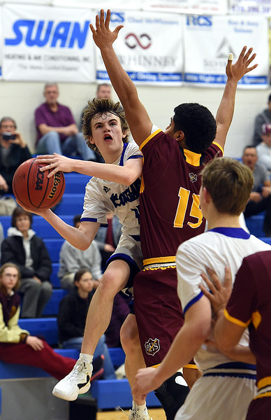 Resurrection Christian's #4 Tanner Ervin goes up for a shot as Brush's #15 Adrian Lopez tries to block during their game Friday, Jan. 13, 2017, at Resurrection Christian School in Loveland. (Photo by Jenny Sparks/Loveland Reporter-Herald)