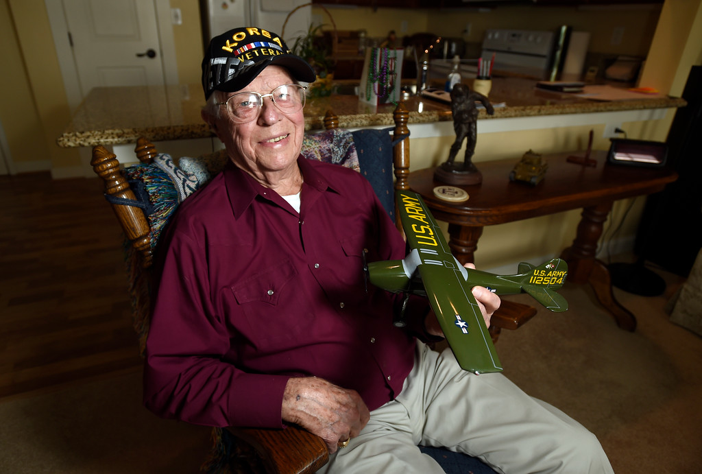 . Retired U.S. Army Major Donald Reininger holds a model of the Cessna L-19 Bird Dog airplane at his home in Louisville on Wednesday. For more photos of Reininger go to dailycamera.com Jeremy Papasso/ Staff Photographer 11/01/2017