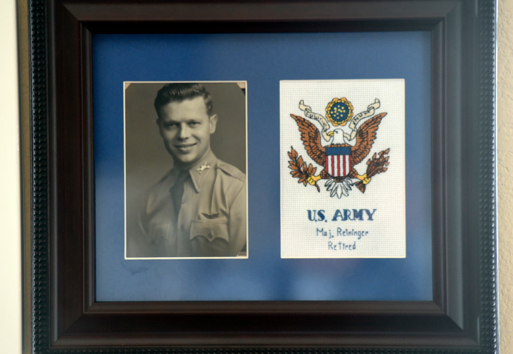. A photograph of Retired U.S. Army Major Donald Reininger hangs on the wall at his home in Louisville on Wednesday. For more photos of Reininger go to dailycamera.com Jeremy Papasso/ Staff Photographer 11/01/2017