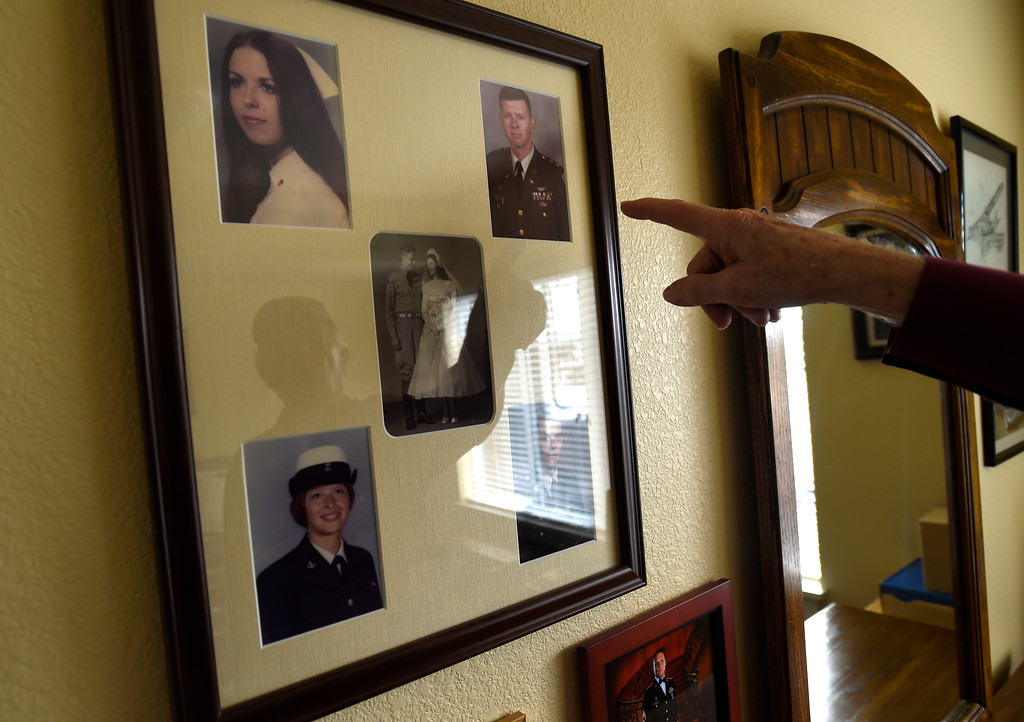 . Retired U.S. Army Donald Reininger points to photographs of his family, all of which have served in the armed forces, at his home in Louisville on Wednesday. For more photos of Reininger go to dailycamera.com Jeremy Papasso/ Staff Photographer 11/01/2017