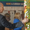 Dr Daniel Asquino, retired President of Mount Wachusett Community College picks a piece of fruit from a pineapple totem during his Retirement Celebration. SENTINEL&ENTERPRISE/ Jim Marabello