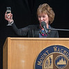 Tina Sbrega, Chairman of the Board of Trustees of Mount Wachusett Community College raises a glass of champagne for a toast to retiring President Dr. Daniel Asquino during his Retirement Celebration. SENTINEL&ENTERPRISE/ Jim Marabello