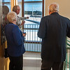 Ann McDonald Executive VP of MWCC shows guests at the Retirement Celebration for Dr. Daniel Asquino the view of the wind turbines from the new Science Wing which is named in Asquino's  honor. SENTINEL&ENTERPRISE/ Jim Marabello