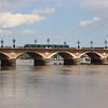 Close up of the Pont de Pierre with one of the modern trams crossing to the other side of the Garonne River.