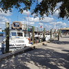 The main street and boardwalk in Tarpon Springs.....the fishing boats are lined up.