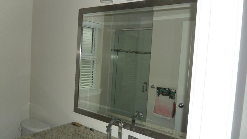Upgraded frameless glass shower door in ensuite bathroom.