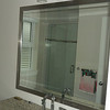 Upgraded frameless glass shower door in ensuite bathroom.