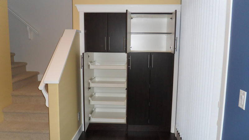 Showing interior of pantries with fixed shelves at top and sliding shelves at bottom..
