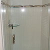 Glass shelves behind new shower door.