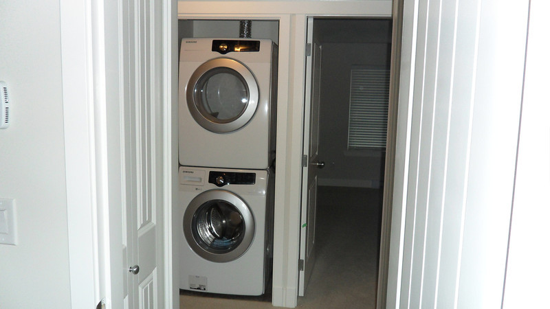 New stacked washer & dryer on 3rd floor next to master bedroom.