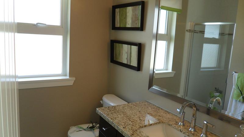 Ensuite bathroom with window.