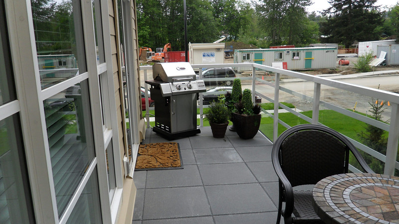 Other end of deck with BBQ and entrance to kitchen.