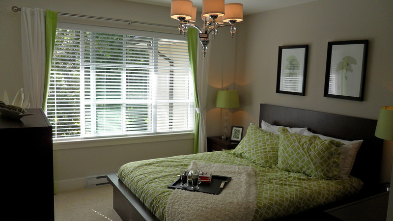 Matser bedroom with large window.