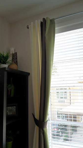 Drapery and very large window in living room.
