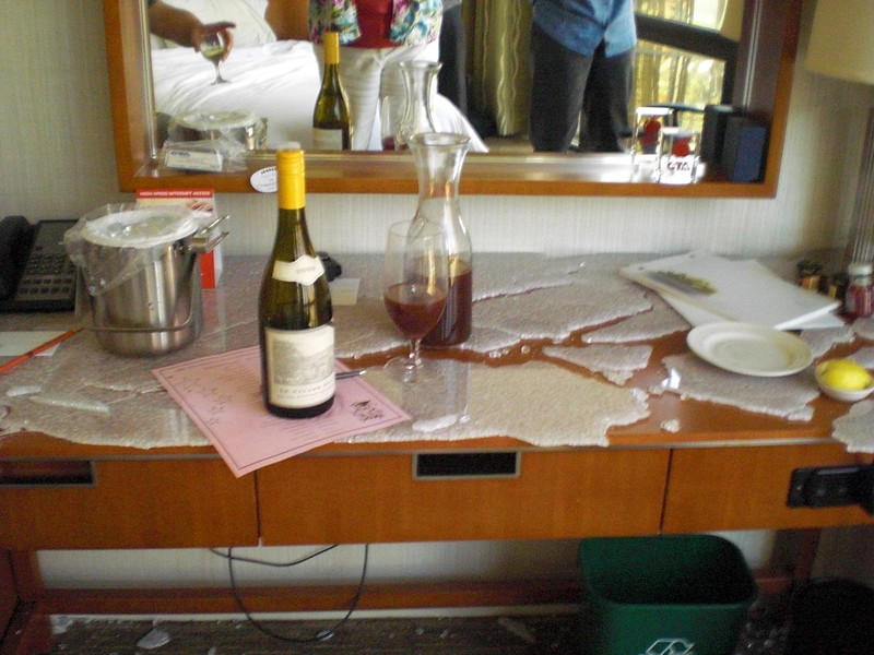 When Mike opened a bottle of wine, the glass on the desk exploded and shattered all over--kept crackling and moving for quite a while after--the mgt. made John and Mark switch rooms as a result of the tempered glass all over...