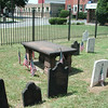 Poor's gravestone is the table in the center